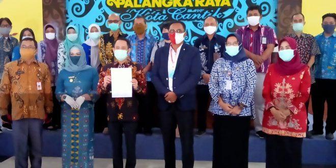 Penyerahan Laporan Hasil Pemeriksaan BPK RI atas Laporan Keuangan Pemerintah Daerah Kota Palangka Raya Tahun Anggaran 2019